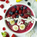 Smoothie bowl with banana, raspberries and blueberries