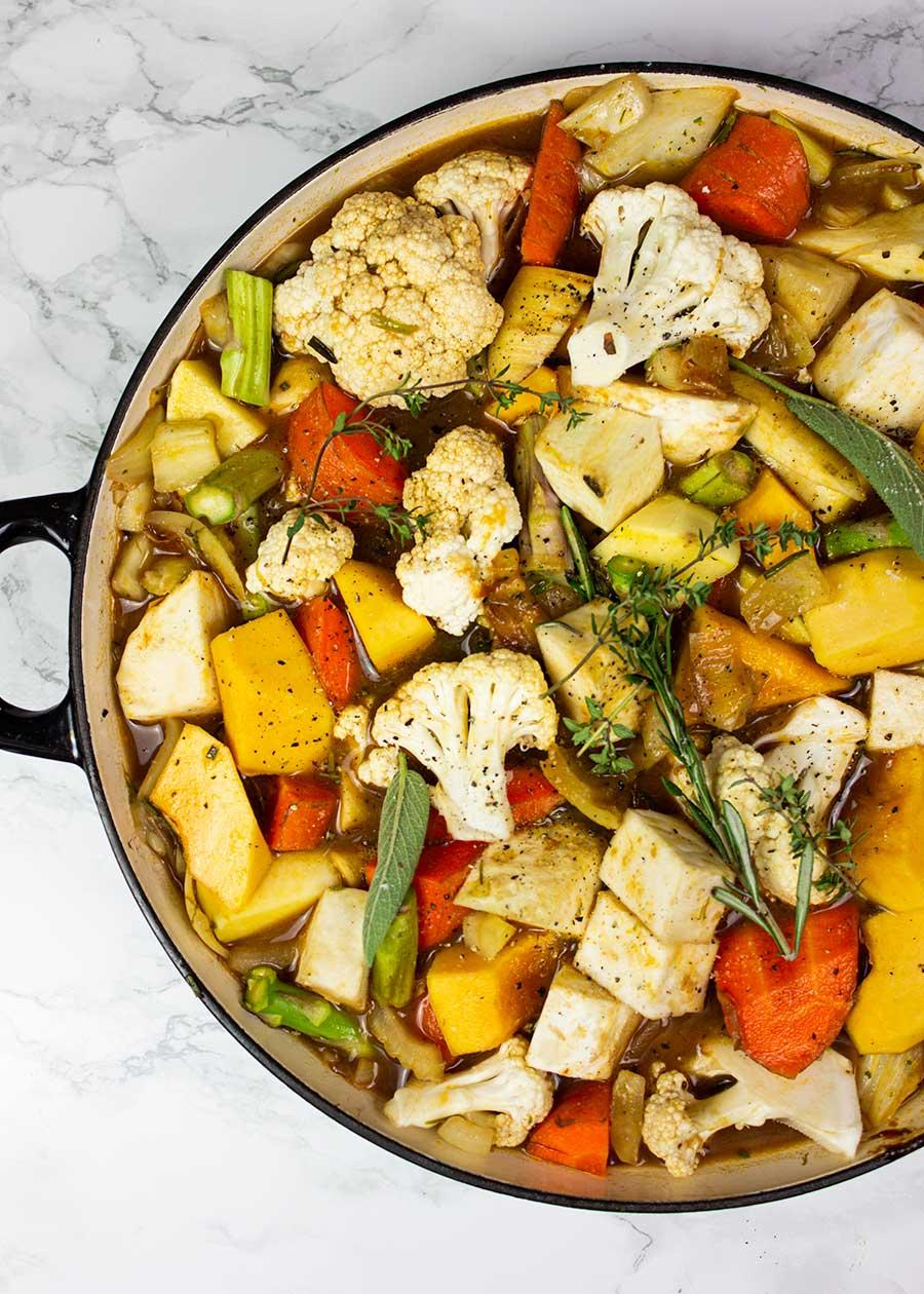 Warming vegetable stew with herby dumplings